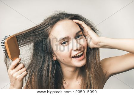 Teenager with hair comb,no problems, happy smiling