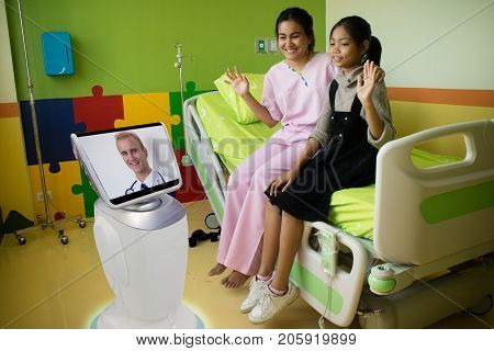 doctor in hospital talk with the patient at patient room by telepresence robotic and it caretakers can interact with their patient check on their living conditions and the need for further appointments
