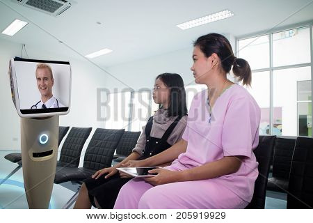 doctor in hospital talk with the patient at reserve room by telepresence robot and it caretakers can interact with their patient check on their living conditions and the need for further appointments