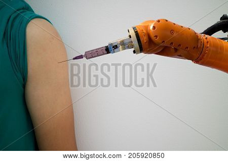 smart robotic in medical concept doctor robot try to inject the medicine on upper arm of the patient it help to faster recovery timeprecising area less cosmetic damage and lower overall costs