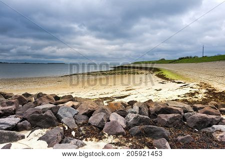 The North Sea coast in Zealand Netherlands. Dutch landscape with view on the dike protects against flooding