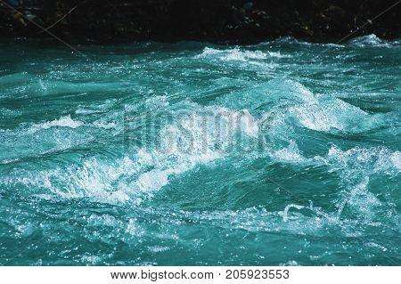 Crystal clear glacial water of the river of turquoise color. Close-up. The concept of pure natural drinking water