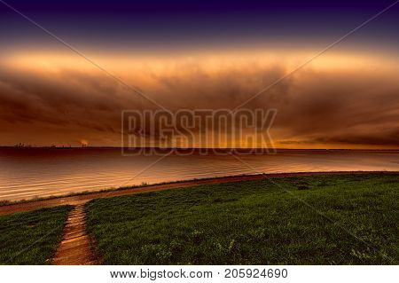 Dunes and sea at the North Sea shore in Holland at sunset. Dutch landscape with dike protects against flooding