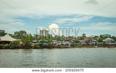 Sarawak Kuching Water Festival in november 2016, where competitors in the regatta are rowing longboats.