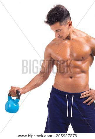 Handsome muscular man lifting a kettle bell, isolated on a white background