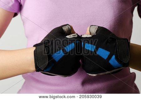 Woman wear bicycle gloves for cycling, protection and safety