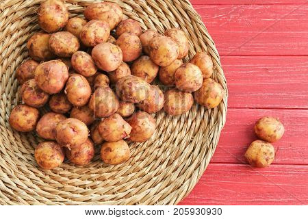 Young potatoes on wicker mat