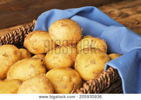 Wicker basket with young potatoes, closeup
