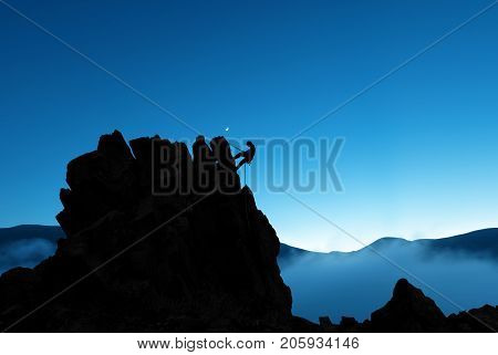Man rock climber silhouette concepts of Courage and Adventure