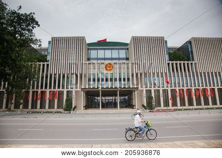 HANOI, VIETNAM - AUGUST 2017: The new National Assembly Building, was a public large building with driver motorcycle, located on Ba Dinh Square across the Ho Chi Minh Mausoleum