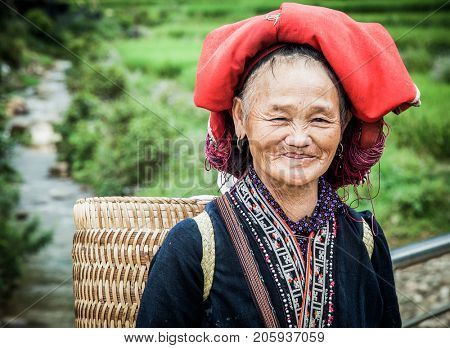 SA PA, VIETNAM - AUGUST 2017: Portrait of Red dzao ethnic minority woman in Ta Phin village, Sa Pa, Lao Cai province, Vietnam