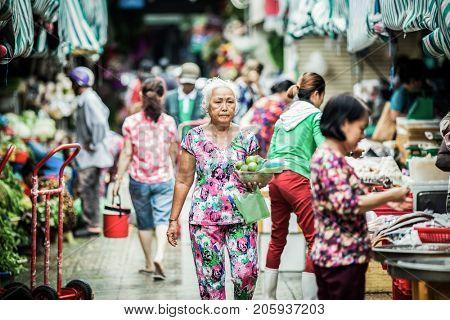 HO CHI MINH CITY (SAIGON), VIETNAM - JULY 2017 : Unidentified vendrs at Ben Thanh market in Saigon, Ho Chi Minh City, Vietnam