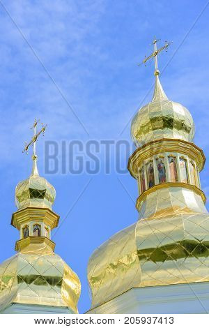 Golden Orthodox Christian crosses on the domes of the churches of Kiev's Pechersk Lavra