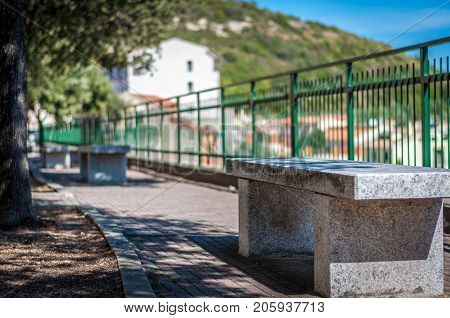 Closeup Of Stone Bench In A Alley In Sunny Day
