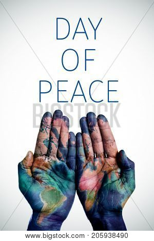 the hands of a young man put together patterned with a world map (furnished by NASA) and the text day of peace, with a slight vignette added