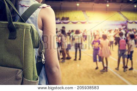 Girl with backpack attend school activities in indoor stadium Education concept.