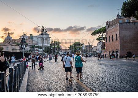 Rome, Italy - August 21, 2016: Via dei Fori Imperiali. It is a road in the centre of Rome that runs from the Piazza Venezia to the Colosseum, next to the Forums of Trajan, Augustus and Nerva