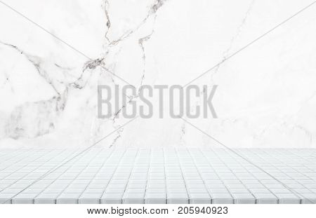 White ceramic mosaic table top and background of white marble stone wall - can used for display or montage your products.