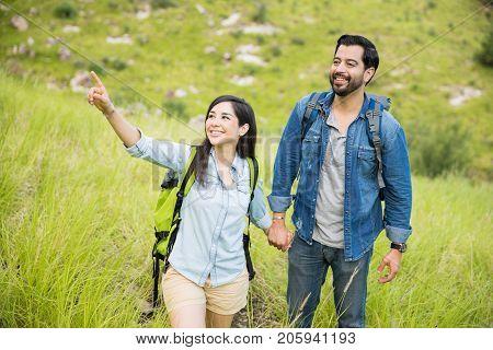 Latin Couple On A Mountain