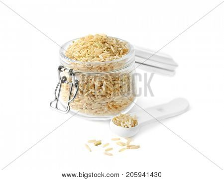 Glass jar of long grain brown rice on white background