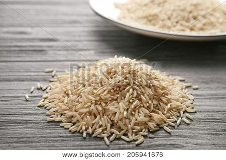 Pile of long grain brown rice on table