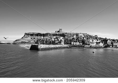 View of the East Cliff, St Mary´s Church and the North sea from the West Cliff of Whitby, North Yorkshire, United Kingdom.