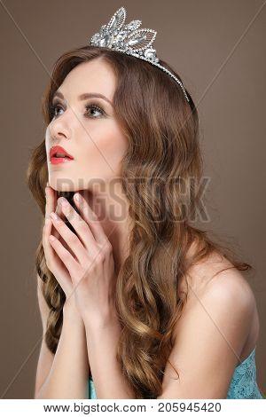 Portrait of beautiful bride. Wedding dress. Wedding decoration.  Brown background