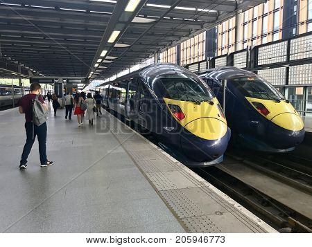 LONDON - SEPTEMBER 3, 2017: Passengers board British Rail Class 395