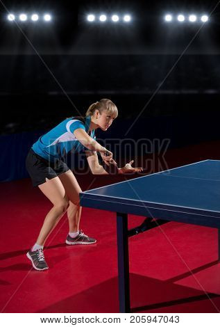 Young woman table tennis player at sports hall