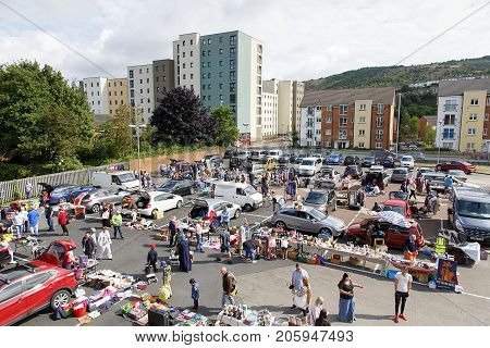 Swansea, UK: August 13, 2017: A car boot sale where local people sell unwanted domestic items or clothes and people buy a secondhand bargain.