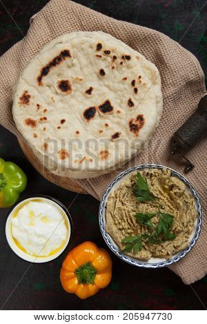 Pita bread, wheat flour flatbread popular in turkish and lebanese cuisine