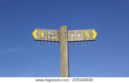 A signpost leads the way to the furthermost western beach on the Gower Peninsular. Rhossili Bay is three miles of golden sand accessed via a steep path down from the clifftop.
