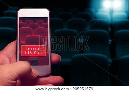 hand holding smartphone for reserved movie ticket. online ticket buying.