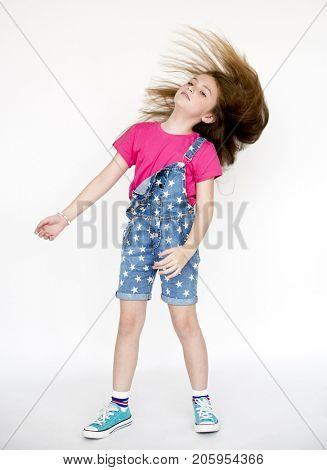 Little Girl Confidence Self Esteem Hair Whip Head Banging Studio Portrait