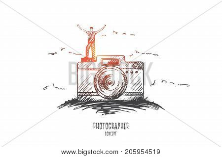 Photographer concept. Hand drawn male photographer standing on camera. Happy person with photo camera isolated vector illustration.