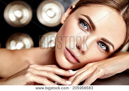 sensual glamour portrait of beautiful woman model lady with fresh daily makeup with nude lips color and clean healthy skin face on studio lights background