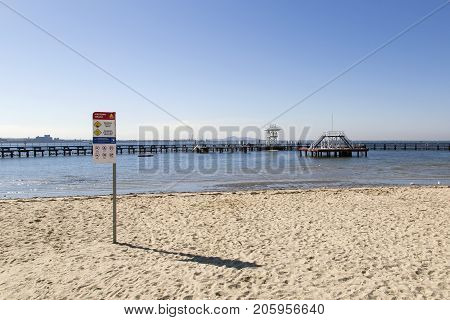 Geelong, Australia: April 03, 2017: Eastern Beach Swimming Enclosure on Corio Bay opened in the 1930's is a protected seawater swimming pool with lifeguards, children's area and a shark gate.