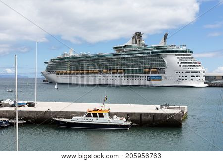 FUNCHAL MADEIRA PORTUGAL - SEPTEMBER 12 2016: Cruise ship is docked in the port of Funchal the capital of Madeira Portugal