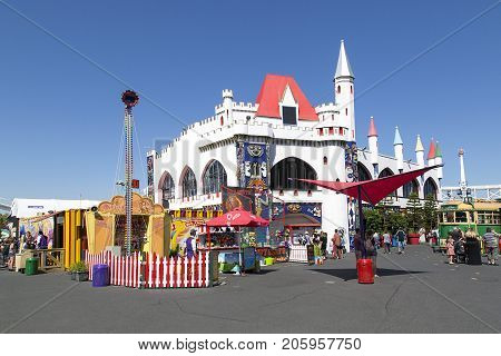 Melbourne, Australia: March 18, 2017: People enjoying the rides and sights at Melbourne's Luna Park. The historic amusement park located on the foreshore of Port Phillip Bay in St Kilda