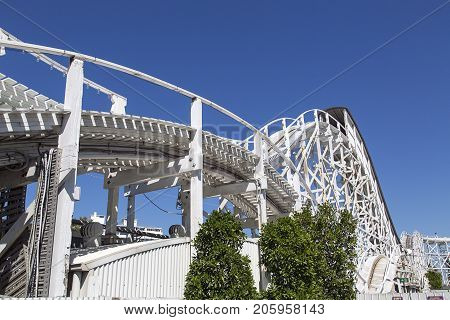 Melbourne, Australia: March 18, 2017: The iconic wooden roller coaster at Melbourne's Luna Park. The historic amusement park located on the foreshore of Port Phillip Bay in St Kilda
