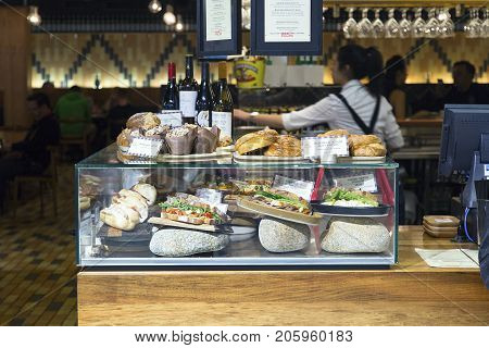 Melbourne Airport, Australia: October 11, 2015: Serving food, drinks and snacks in the departure lounge at Tullermaine airport in Melbounre. The food is very expensive when purchased flight side.