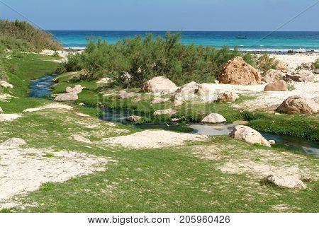 Freshwater stream that flows into the sea at Arher beach on Socotra island, Yemen