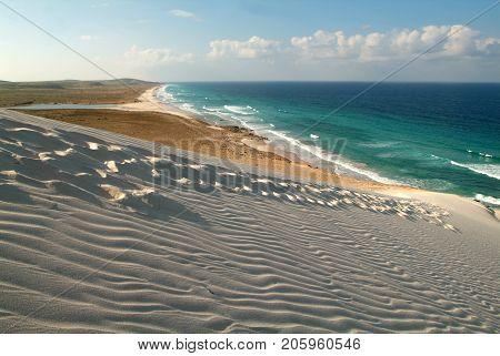 Human footprints on the white sand of Deleisha beach on Socotra island, Yemen