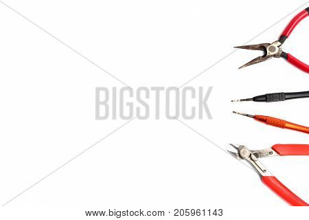 Flat lay of various craftsman tools or hand tools on white background with copy space using as construction tools workshop and craft concept.