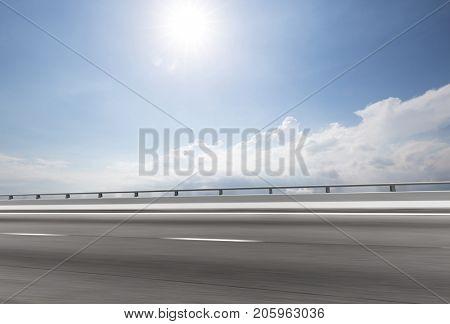 blur emtpy asphalt road in blue cloud sky
