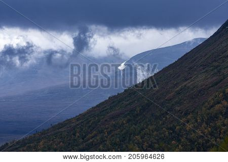 September and heavy clods above the mountain. Rain in the forecast.