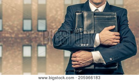 Concept of a stressed businessman under pressure. Fear of job loss.