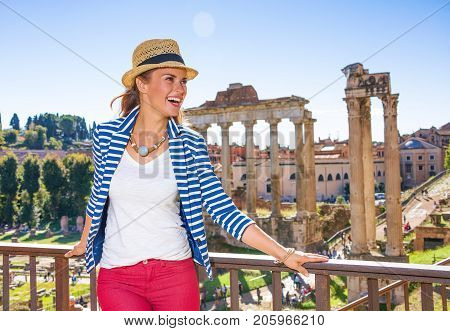 Tourist Woman In Front Of Roman Forum Looking Into Distance