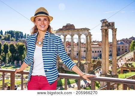 Woman In Front Of Roman Forum Looking Into Distance