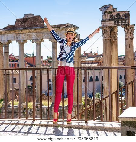 Smiling Woman In Front Of Roman Forum In Rome, Italy Rejoicing